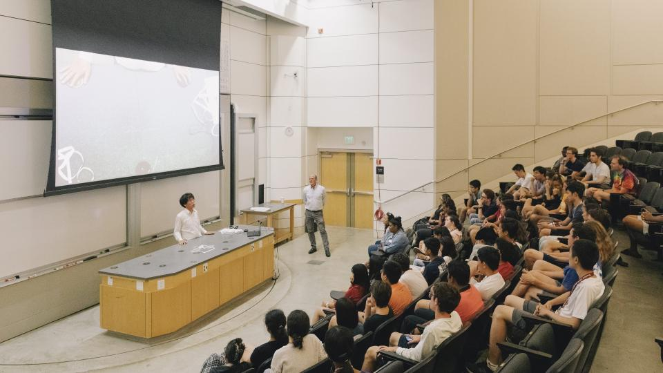 A group of participants attend a guest lecture.